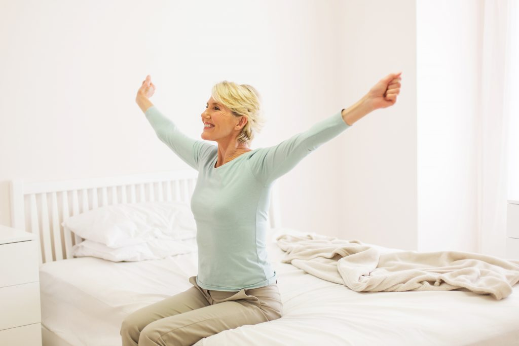 middle aged woman getting up